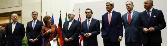Foto: Reuters Die 5 + 1 Gruppe und die iranische Delegation bei der Bekanntgabe der Einigung im Atomstreit in Genf