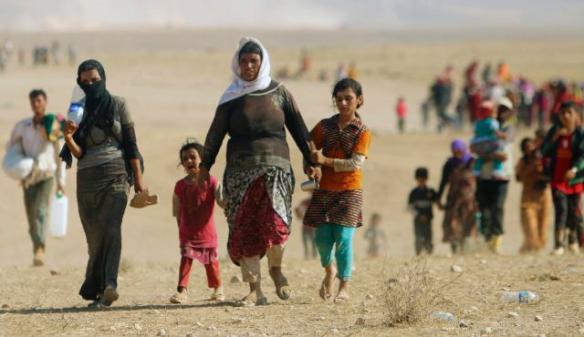 Foto: Reuters Vertriebene der Minderheit der Yeziden, auf der Flucht vor der Gewalt der Terroristen des Islamischen  Staates in Sinjar, in Richtung der syrischen Grenze am 11. August 2014