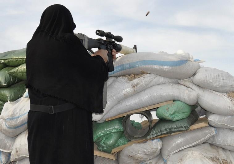 Bildquelle: ©REUTERS Verschleierte Frau schießt Beispielfoto
